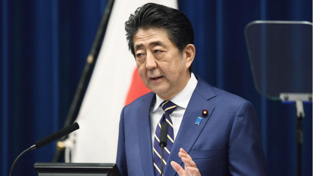 Calls grow for Japan PM to declare state of emergency over virus