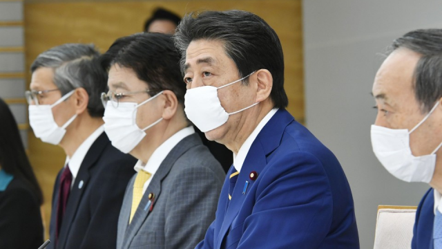 Japan PM Abe declares state of emergency amid widespread virus infections